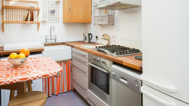 The small galley kitchen at 2 Eden Road Lower in Glasthule is lit from above by a Velux window.