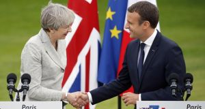 British prime minister Theresa May at the Élysée Palace in Paris with French president Emmanuel Macron. Photograph: Thierry Chesnot/Getty Images