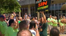Gay men's chorus group drown out anti-gay protesters at Pride festival