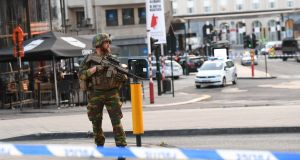 A soldier cordons off an area outside Brussels Central Station, after an explosion in the Belgian capital.  Photograph: Emmanuel Dunand/AFP/Getty Images