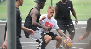 Justin Bieber pictured playing basketball in Bushy Park in Terenure on Tuesday evening. His car was surrounded by fans on exit. Photograph: Aidan Crawley