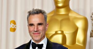 File image of actor Daniel Day-Lewis posing with his Oscar for best actor for his role in 'Lincoln', in Hollywood, California, the US. File photograph: Mike Blake/Reuters