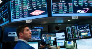 US stocks extended their losses in early afternoon trading on Tuesday, slipping from record levels, as a sharp drop in oil prices squeezed energy stocks and a rebound in technology shares faded out. Photograph: Drew Angerer/Getty Images