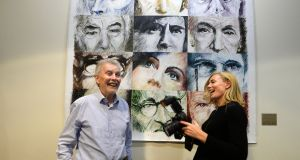 Artist Claus Havemann, who doanted his painting Irish Eyes to the National Library, is photographed by his daughter Krestine Havemann at the library on Tuesday. Photograph: Cyril Byrne