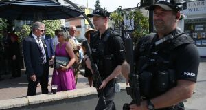Armed police officers on  patrol  as racegoers arrive on day one of the Royal Ascot horse racing meet, in Ascot, west of London. Photograph: AFP/Getty Images