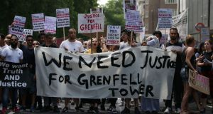 Demonstrators  march  through London during an anti-government protest following the deadly fire at Grenfell Tower. Photograph: Daniel Leal-Olivas/AFP/Getty Images