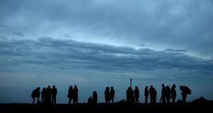People gather at dawn on the Hill of Tara for the Summer Solstice Sunrise on the shortest night of the year.   Photograph: Alan Betson / The Irish Times