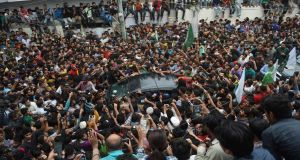 """War by sporting means"": cricket fans gather around the vehicle carrying the Pakistan  captain, Sarfraz Ahmed, through Karachi after his team's surprise victory over India. Photograph: Rizwan Tabassum/AFP/Getty"