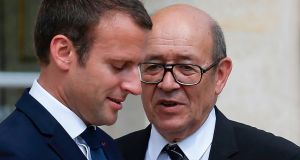 French president Emmanuel Macron  speaks with foreign minister Jean-Yves Le Drian: Mr Macron has achieved his goal of splitting the conservatives. Photograph: Geoffroy van der Hasselt/AFP/Getty