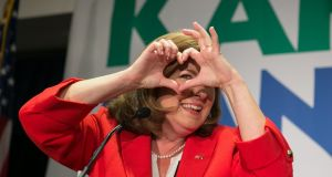 Republican Karen Handel makes  a heart sign for her supporters ahead of her election victory in Atlanta, Georgia. Photograph: Jessica McGowan/Getty Images