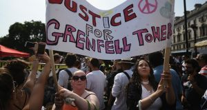 Protesters hold a banner calling for justice for the victims of the Grenfell Disaster in Parliament Square during an anti-government protest on June 21st, 2017 in London. Photograph: Carl Court/Getty Images