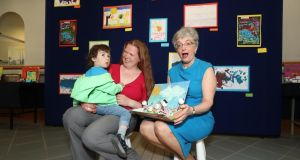 Arta Runika and her son Emmett (2) with the Minister for Children and Youth Affairs Katherine Zappone at a recent Tusla conference in Dublin on family support