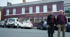 Father and son Terry and Terry McKevitt outside their McKevitt's Village Hotel in Carlingford. Photograph: Enda O'Dowd
