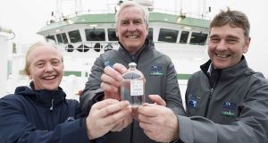 The Canadian Ambassador to Ireland, Kevin Vickers, is presented with a water sample from the deep ocean by Dr Caroline Cusack and  Dr Peter Heffernan of the Marine Institute.   Photograph: Andrew Downes