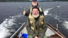 The late Dick Warner heading out for a day's fishing on Lough Mask with Cyril Bogg.