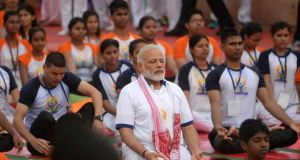 India's prime minister Narendra Modi engaged in a mass yoga session to mark International Yoga Day:  has promised to repeal 10 obsolete laws for every new one passed. Photograph: Sanjay Kanojia AFP/Getty Images