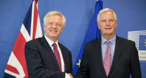 UK Brexit secretary David Davis and Michel Barnier, chief negotiator for the European Union, shake hands ahead of the start of Brexit negotiations in Brussels on Monday. Photograph: Jasper Juinen/Bloomberg