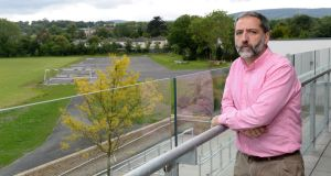 Edward Melly, principal of Clonkeen College, Blackrock, Co Dublin,  with view of school grounds which are to be sold by the Christian Brothers. Photograph: Dara Mac Dónaill