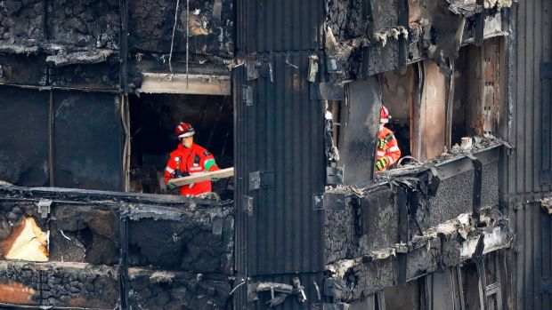 Combustible cladding: members of the emergency services work on the remains of Grenfell Tower. Photograph: Tolga Akmen/AFP/Getty