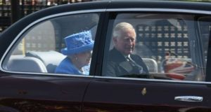 Queen Elizabeth travelled with Prince Charles in her official car to Westminster.