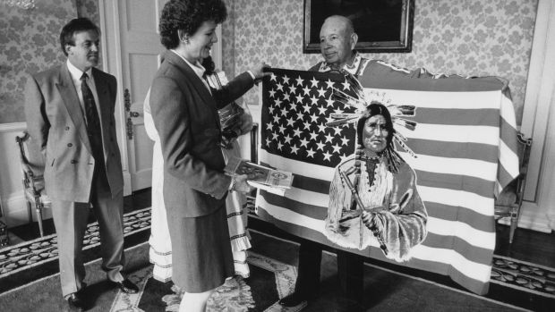 President Mrs Mary Robinson is made an honorary Chief of the Choctaw Indian nation of Oklahoma by Randal Dorant (right) speaker of the Choctaw tribal council at Aras an Uachtaráin in 1992. Photograph: Joe St Leger