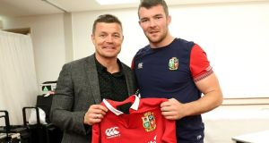Brian O'Driscoll (left) presents the jersey to Peter O'Mahony ahead of the first test against New Zealand on Saturday. O'Mahony will captain the side. Photograph: via Twitter