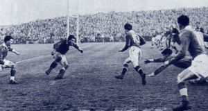 Jack Kyle scores a try against France in  Belfast in 1953.