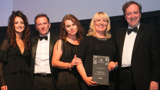 Lynn Lambe, Marketing Manager, Ecocem Ireland presents the Building of the Year award to the, McCauley Daye O'Connell Architects team.