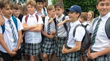 Boys wear skirts to school in protest over shorts ban