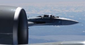 A Russian jet coming within a few feet of a US Air Force reconnaissance jet over the Baltic Sea on June 19th. Photograph: Master Sgt Charles Larkin Snr/US European Command via AP