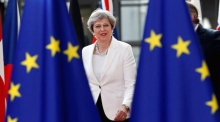 Theresa May looks to reassure EU citizens living in the UK