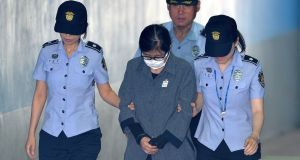 Choi Soon-sil arriving at a court in Seoul, South Korea on Friday where she received a three-year jail sentence. Photograph: Park Ji-hye/News1 via Reuters