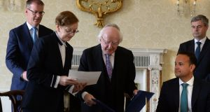 Máire Whelan has her appointment to the  Court of Appeal rubberstamped by President Michael D Higgins, as crafty Leo looks on. Photograph: Cyril Byrne