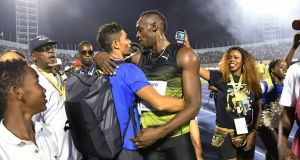 "Jamaica's Usain Bolt  embraces South African sprinter Wayde van Niekerk after winning the ""Salute to a Legend"" 100 metres during the Racers Grand Prix at the national stadium in Kingston, Jamaica. Photograph: Bryan Cummings/AP"
