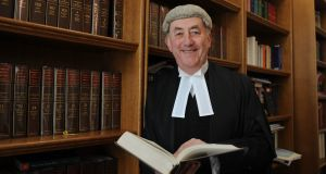 Mr Justice Peter Kelly pictured in his chambers