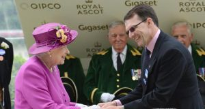 Queen Elizabeth II of England, and Irish trainer Aidan O'Brien on day five of Royal Ascot. Photograph: Getty Images