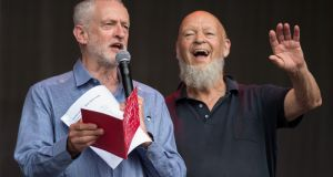 Britain's opposition Labour Party leader Jeremy Corbyn (left)  with Glastonbury festival founder Michael Eavis on the Pyramid Stage  on Worthy Farm near the village of Pilton in Somerset, southwest England,  June 24th, 2017. Photograph: Oli Scarff/AFP/Getty Images