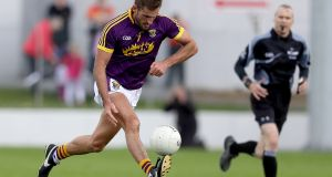 Wexford defender Brian Malone on the move. Photograph: Inpho