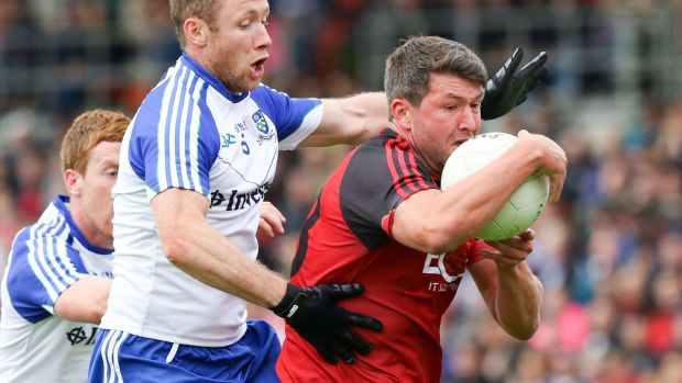 Down's Peter Turley holds on as Vinny Corey of Monaghan tackles him. Photograph: Inpho