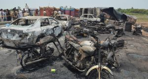 Burnt vehicles at the scene of an Oil tanker accident on the outskirts of Bahawalpur, Pakistan. Photograph: EPA