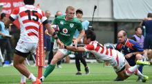 Ireland's fullback Andrew Conway eludes the tackle of  Japan winger Kenki Fukuoka  during the Test match in Tokyo. Photograph: kazuhiro Nogi/Getty