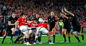 British and Irish Lions scrumhalf Conor Murray kicks the ball clear of danger during the Lions' first Test match against the All Blacks. Photograph: David Gray/Reuters