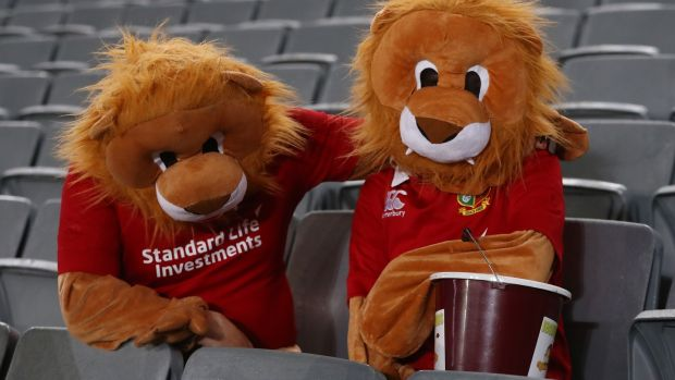 Two people in full lion costumes look disconsolate at the final whistle. Photo: David Rogers/Getty Images