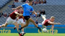 Dublin's Niall Scully has his shot blocked by Killian Daly. Photograph: Inpho