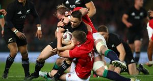 Ben Smith of the All Blacks is tackled by Lions duo Alun Wyn Jones and Owen Farrell  during the first Test at Eden Park. Photograph: Hannah Peters/Getty Images