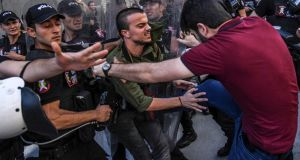 A plain-clothes police officer kicks a member of a group of LGBT rights activist as Turkish police prevent them from going ahead with a gay pride annual parade on Sunday in Istanbul, a day after it was banned by the city governor's office. Photograph: AFP