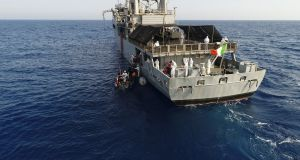LÉ Eithne  rescues a total of 135 migrants from an inflatable craft about 83km northwest  of Tripoli on Sunday. Photograph: Defence Forces