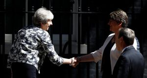 British prime minister Theresa May, shakes hands with DUP leader Arlene Foster outside 10 Downing Street  ahead of talks  . Photograph: Stefan Wermuth/Reuters