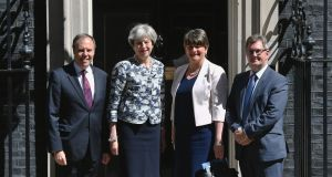 British prime minister Theresa May, meets  DUP leader Arlene Foster, DUP deputy leader Nigel Dodds and MP Sir Jeffrey Donaldson outside 10 Downing Street  ahead of talks. Photograph: Dominic Lipinski/PA Wire