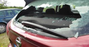 A car with its rear window smashed  Some of the cars that were broken into at th eShay Elliot car cark on Saturday. Photograph: Helen Lawless